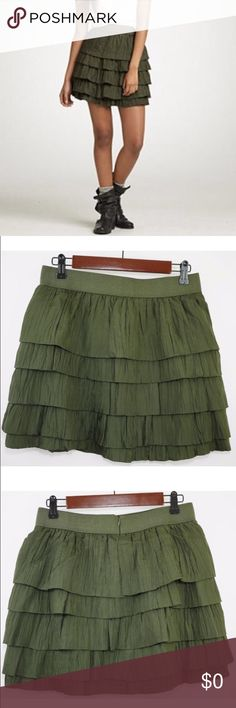 """J. Crew Tiered Ruffle Green Mini Skirt w Grosgrain J. Crew Tiered Ruffle Green Mini Skirt w Grosgrain Waistband --- 2 --- 100% silk tiers (5) with a cotton lining and a Grosgrain waistband --- back zipper with hook and eye closure --- silk is crinkly --- 14"""" waist --- 16"""" length --- perfect like new condition --- thank you for visiting my boutique, please feel free to ask any questions J. Crew Skirts Mini"""