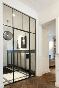 Hal met stalen deuren, J.J. Viottastraat | Kodde Architecten