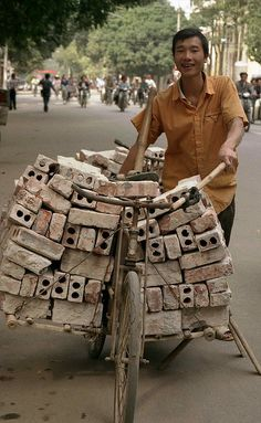 Transporting bricks; Hanoi, Vietnam