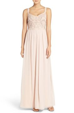 Free shipping and returns on Adrianna Papell Embellished Bodice Chiffon Gown at Nordstrom.com. Dainty beads and shimmering sequins trace an elegant motif across the bodice of a romantic chiffon gown. Slender straps and a sweetheart neckline showcase pretty shoulders and décolletage, while lavish gathers at the natural waist offer soft volume and graceful movement to the sweeping skirt.