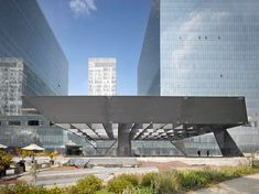 the cervantes theater by ensamble studio is denoted by a large metallic structure that shoots upward into the public square of plaza carso in mexico city.