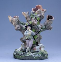 Staffordshire figure of a Piping Shepherd Spill Vase