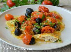 Ravioli ripieni di branzino con olive nere e pachino