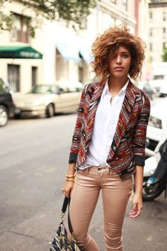 crisp white top, tribal printed jacket, rose gold jeans, and big hair