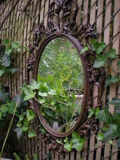 A mirror in the garden adds interest as well as di...