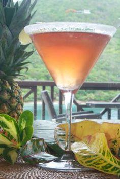 Scrub-Tini: A tropical martini combining rose Champagne, raspberry vodka, & lime juice.