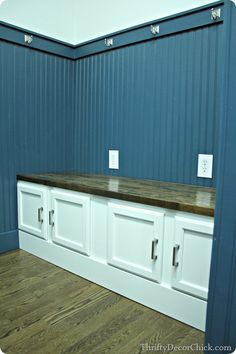 A mudroom bench made out of kitchen cabinets. Full installation tutorial! #DIY #mudroom