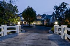 This is one of two driveway bridges with lanterns atop pillars that cross natural streams to reach the house. Description from landscapeonline.com. I searched for this on bing.com/images