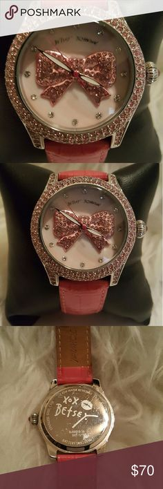 Women's fun and beautiful Betsy Johnson watch. Womens really gorgeous Betsey Johnson watch with lots of pink colors including a large pick bow in the center of the watch housing. This isn't gonna last long to sell sooooooo, you may want to not be too hesitant:-) Betsy Johnson  Accessories Watches