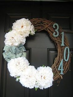 Wreaths. So cute! Good gift idea.    So I made this for our door, minus that many flowers and plus an 'L' in the middle.  Kinda a combo of the large letter only and wreath.  Did not add the numbers, I thought it was too busy.