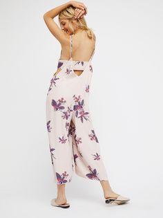 Dream Big Jumpsuit | Printed wide leg jumpsuit in an oversized and effortless fit featuring dropped armholes and a low cut back. Band in back with delicate button closures on the side and hip pockets.