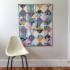 """Quilt Stats: Finished dimensions: 34"""" x 42.5"""" Fabrics used include: Prints from the Echo collection by Lotta Jansdotter for the top and binding; large beige circles by Marimekko for Crate and Barrel for the back. Quilt pattern: An original Salty Oat design"""