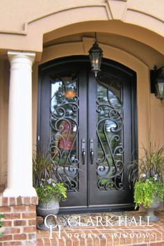 The ornate style of these custom iron front entry doors transforms the entire design of the home's entrance. With large glass windows to let in the natural light, these custom made double doors take exterior double door ideas to the next level. Main Entrance Door, Door Entryway, Entry Doors, Arched Doors, Iron Front Door, Double Front Doors, Front Entry, Main Door Design, Front Door Design