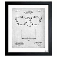 Framed art print with a Ray-Ban blueprint motif. Made in the USA.   Product: Framed printConstruction Material: Canvas and woodColor: Black frameFeatures:  Made in the USAReady to hang  Cleaning and Care: Dust lightly