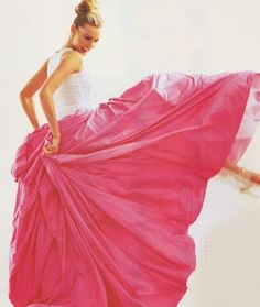 Absolutely fabulous vivid pink skirt made with yards of fabric; length probably to the ankle. Perfect for partying, dancing, flirting . .