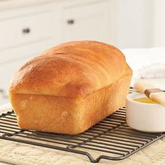 Pam's Country Crust Bread | This top-rated bread has a tender crumb and soft crust. Slice and spread with butter for your favorite meal.