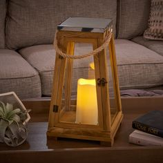Newport Candle Lantern: Natural wood, stainless steel top and rope handle make this piece a classic. Flameless candle runs on 6 hr on / 18 h off timer. #CandleLantern #Lantern #DecorativeLighting #BatteryPowered