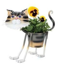 "Stray Tiger Cat - indoor or outdoors (garden) décor plant stands. Holds 4"" grower pot - 11.5"" inches tall by Georgetown USA. $32.25. stand alone. requires no tools for assembly. made of metal. 4"" pot and 11.5"" tall. weather resistant finish. 4"" Pot, 11.5"" Tall, Metal planters are constructed of steel with a painted coating. . The planters do not have drainage holes so that they may be used indoors. Use a hammer and nail or a drill to add drainage holes. The rings on the ..."