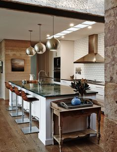 For the brave, a green marble benchtop adds subtle sophistication. Teamed here… Transitional Coffee Tables, Transitional Living Rooms, Transitional House, Marble Benchtop, Rammed Earth Homes, Transitional Chandeliers, Transitional Lighting, Inside Home, Home