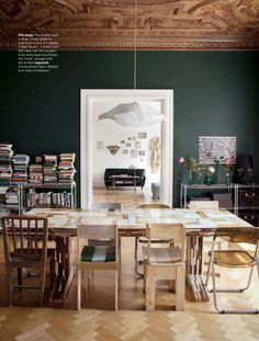 I love this dining room with deep Forest Green walls and the mix of Mid Century Modern chairs.