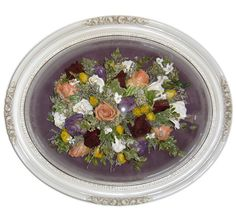 Frame domes are eye-catching and give your keepsake dimension. Each frame dome is customized to coordinate with your bouquet and reflect your personal style. We