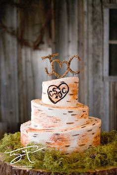 Rustic Wedding Cake REALLY cute, love the heart on the cake and the topper