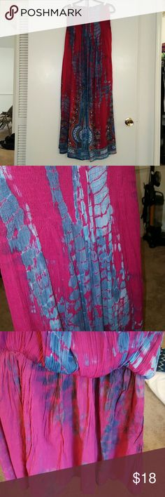 """Bright, beautiful tie dye halter string Maxi, S/M The colors in this dress are amazing! True color shows best in pic 2: magenta/raspberry w/shades of teal and turquoise. Bottom design is exquiste with yellow, orange, white, and purple. Built in liner comes to mini skirt length. Made in India. Dress 100% rayon, liner 100% cotton. I only wore a couple times and handwashed/flat dried. I am only 5'2"""" and this was too long and the abundance of fabric was overwhelming for my frame. It's sized…"""