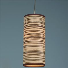 Zebra Wood Veneer Lamp - a thin sheet of veneer wood apprearance is formed into a modern cylinder pendant. The light is warm and inviting shining threw the veneer. (brushed nickel canopy)