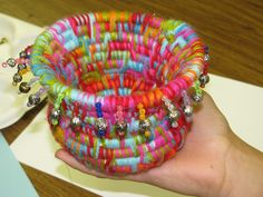 """5th grade coiled yarn basket weaving with beaded fringe; approx . 5"""" tall; lesson by art teacher: Susan Joe"""