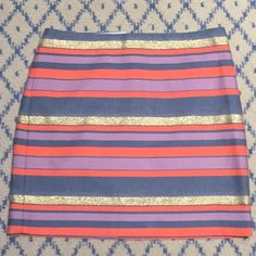 J Crew Striped Mini Skirt J Crew gold blue chambray orange purple striped skirt size 00. Has an inner lining attached. brand new without tags J. Crew Skirts Mini