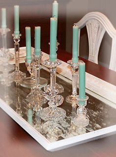 Decor: lovely grouping of candles and candlesticks - really makes a ...