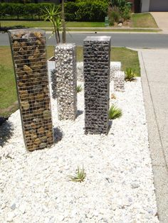 gabion baskets see through or filled with army boots as standing stones?