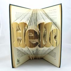 HELLO Folded Upcycled Book Art Sculpture. £45.00, via Etsy.