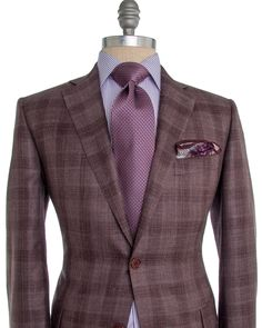 Belvest Burgundy Plaid Sportcoat 2 button jacket Notch lapel Burgundy melton Flap pockets Front left chest pocket Fully lined Burgundy lining Double vent 43% wool, 32% silk, 25% linen Made in Italy