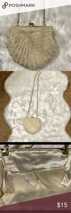 Beaded Clamshell Evening Bag Vintage beaded clamshell shaped purse. Lined with cream color fabric with one inside pocket. Has a long gold shoulder strap chain, 17 inches. The purse is lined in gold metal with some tarnish but the purse fabric and beads are perfect! Bags Clutches & Wristlets