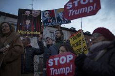 """<p>People hold placards as they gather during an anti-Trump rally in Madrid, Friday, Jan. 20, 2017. Donald Trump took the oath of office as the 45th President of the United States. Few placards read in Spanish: """"Puppet"""" , top left, and """"Trump promotes wars"""". (AP Photo/Francisco Seco) </p>"""