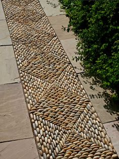 pebble rug in paving
