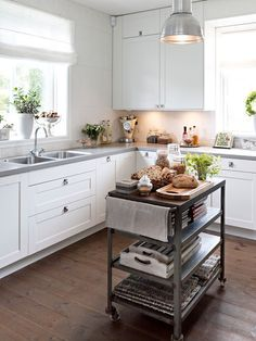 Industrial grey cart used as a kitchen island.