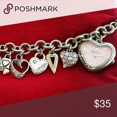 """Brighton charm bracelet watch Bracelet/watch containing 11 charms in addition to heart-shaped watch with pink face and inscription 'LIVE IN THE MOMENT'. 8"""" long with ability to fasten to open links making it shorter to fit smaller wrists. Brighton Jewelry Bracelets"""