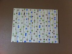 Easy DYI art/paining project. Just need canvas, paint, round sponges, and painter's tape!