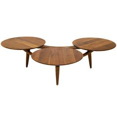 TITLE:	 Walnut Coffee Table Three Disks -after Greta Grossman  PRICE:	$2,400 Purchase >  IN THE STYLE OF:	 Greta Grossman (Designer)  COUNTRY:	 United States  CREATION DATE:	 1950's  MATERIALS:	 Walnut  CONDITION:	 Good. No scratches or stains  LENGTH:	 4 ft. 4.5 in. (133 cm)  DEPTH:	 38 in. (97 cm)  HEIGHT:	 13 in. (33 cm)  DEALER LOCATION:	 San Francisco, CA  NUMBER OF ITEMS:	 1  REFERENCE NUMBER:	 LU9155768383