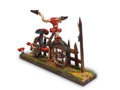 Bicicleta hecha con pasta de modelar, madera, cartón y un toque de arena de playa. Medidas aproximadas: 18 cm de alto, 30 cm ancho.
