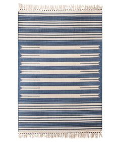 I love that this flat-weave rug feels masculine and feminine at the same time, with beaded fringe and a subdued cream and indigo palette. The timeless stripe pattern makes it a fit for any space: dining room, entryway, office, and more.