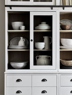 Neptune Chawton - Bookcase Display Cabinets - Kitchen Dresser painted in Snow Moving House, Cabinet, Bookcase Styling, Large Dresser, Bookcase, Bars For Home, Kitchen Dresser, Sliding Cabinet Doors, Kitchen Organisation