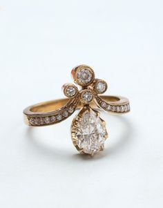 Vintage-inspired Tiara wedding ring from Trumpet & Horn / http://www.deerpearlflowers.com/sparkly-engagement-rings-for-every-kind-of-bride/