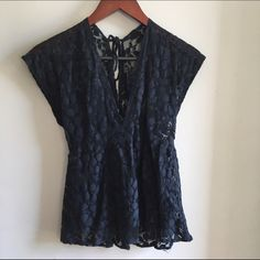 Meshy navy blue top Super cute. V neck. Tie in back more like a small. Rue 21 Tops