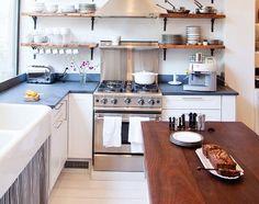 wooden butcher block countertop with built in cutlery storage