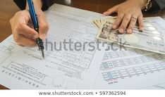 Business woman hand hold pen fill in the details on the tax forms paper in business concept Pay Taxes, Business Women, Holding Hands, Hold On, Fill, Photo Editing, Royalty Free Stock Photos, Concept, Woman