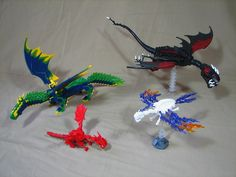 Dragons by :jovian: Dragon display I took to BrickFair this year. They won two awards, seen here. From top right: earth, air, fire, water.