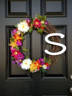 Front door wreath for summer with bright flowers!